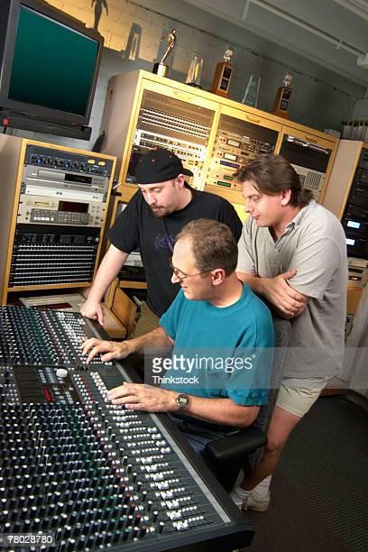 Men using audio mixer