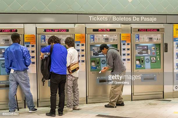 Men using the ticket vending machines at Hollywood Highland station