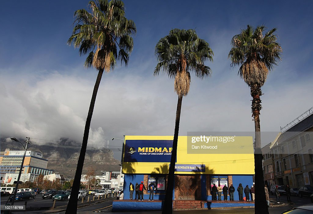 Men wait for a liquour store to open on June 15, 2010 in Cape Town, South Africa.