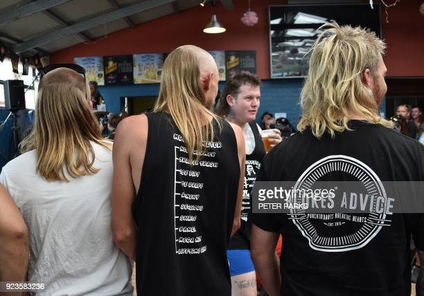 Men wait to be judged on their mullet hairstyles at Mulletfest 2018 in the town of Kurri Kurri 150 kms north of Sydney on February 24 2018 Mulletfest...