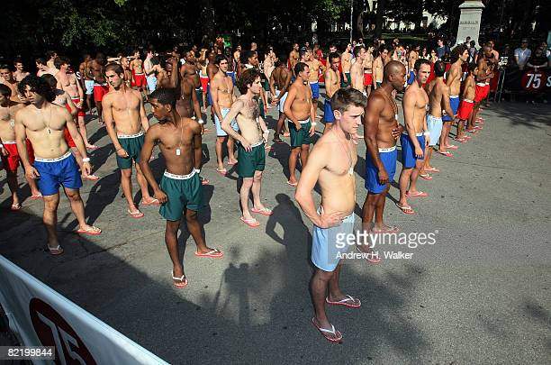 Men wait to be sized up at the Levi's Size Does Matter game on August 6 2008 in New York City