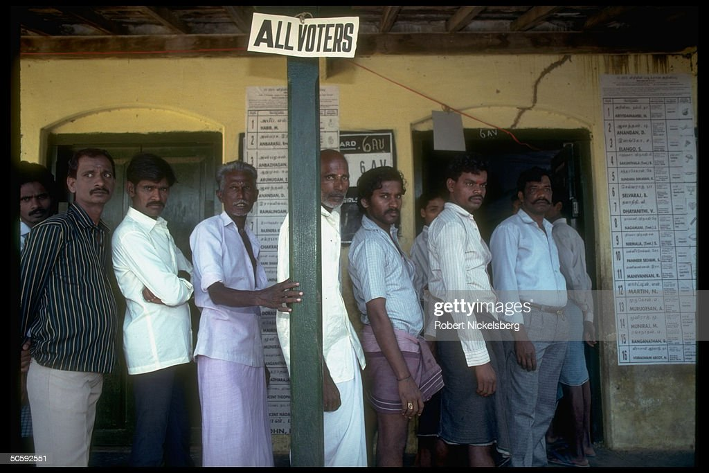 Men waiting in line to cast ballots in G : News Photo