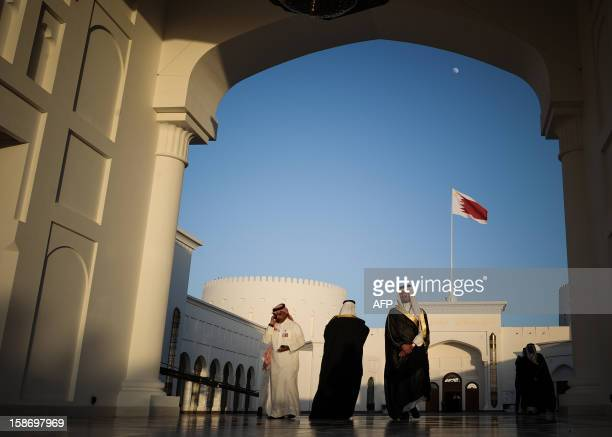Men walk along the corridor at the Sakhir Palace in Manama on December 24 as delegates attend the annual Gulf Cooperation Council summit The annual...