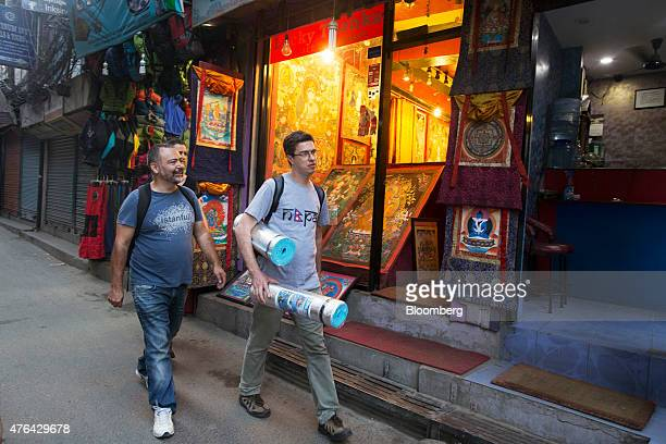 Men walk down a street in the Thamel area of Kathmandu Nepal on Friday May 29 2015 Nepal's gross domestic product will probably grow 38% in the year...