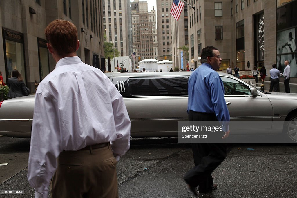 Men walk in front of a stretch limousine on September 28, 2010 in New York City. A new report released by the U.S. Census Data shows that the income gap between Americans is greater than at any other time on record. The report found that the top-earning 20% of Americans received 49.4% of the country's total income. Conversely, those living below the poverty line earned 3.4% of the national income. This is the highest disparity of wealth among all Western industrialized nations.