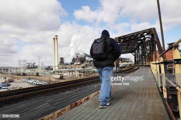 Men walk into the United States Steel Corporation plant in the town of Clairton on March 2 2018 in Clairton Pennsylvania In a controversial move that...
