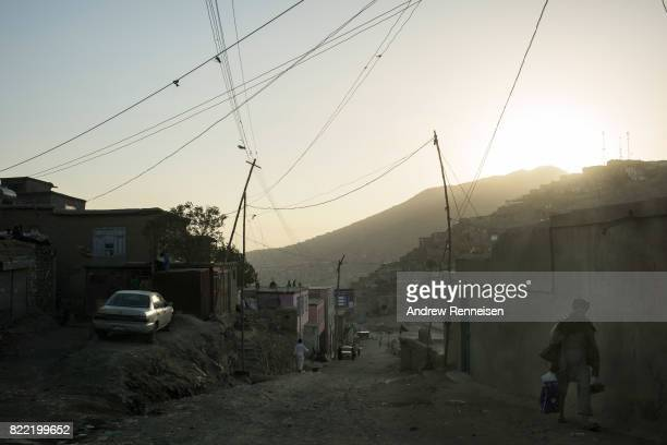Men walk on a street in the western neighborhood known as TV Hill on July 20 2017 in Kabul Afghanistan Despite a heavy security presence throughout...
