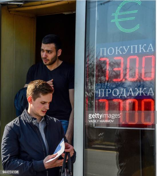 Men walk out from a currency exchange office in Moscow on April 10 2018 Russia's central bank on Tuesday sought to reassure the public after new US...