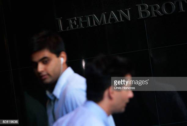 Men walk outside the headquarters of the financial firm Lehman Brothers Holdings Inc September 15 2008 in New York City Lehman Brothers filed a...