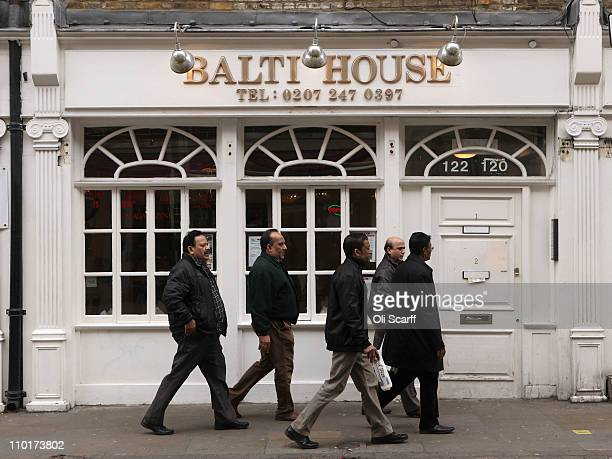 Men walk past a curry house on Brick Lane which is synonymous with curry restaurants on March 16 2011 in London England From April 2011 the...