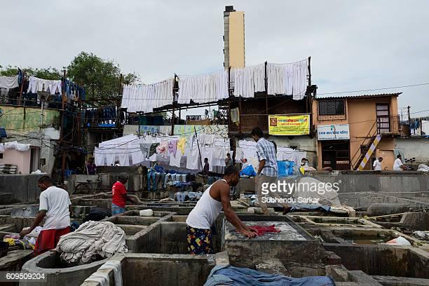 Men wash clothes at an openair laundromat near Cuffe Parade in South Mumbai
