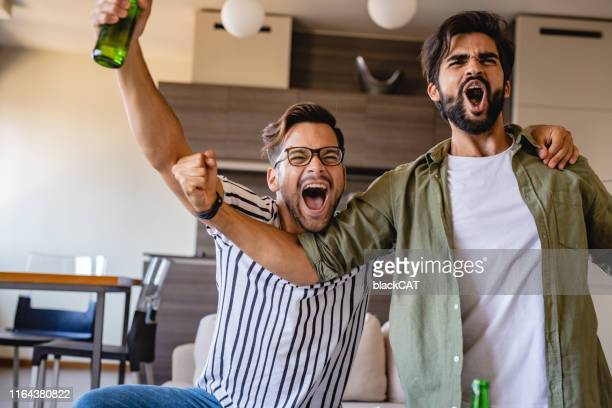 men watch a sports game - sports betting stock pictures, royalty-free photos & images