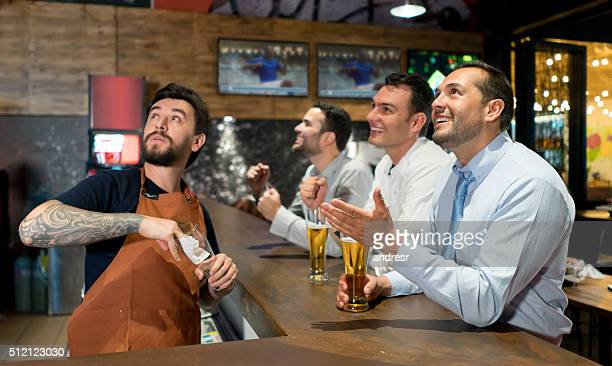 Men watching football at a sports bar