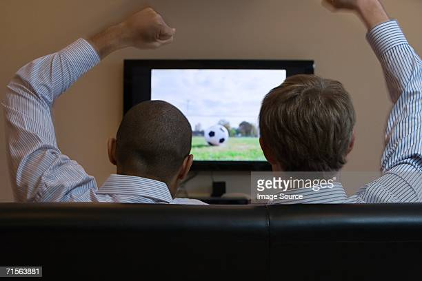 Men watching football on television