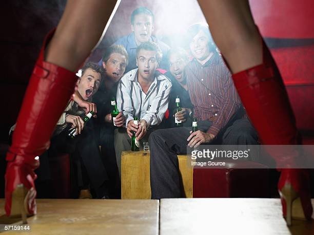 Men watching strip tease