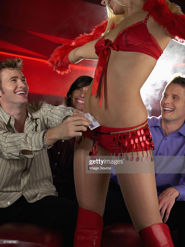 Men watching strip tease : Stock Photo
