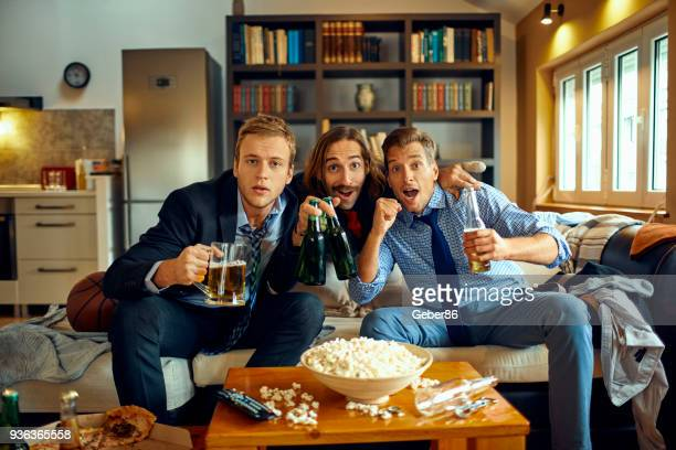 Men watching television