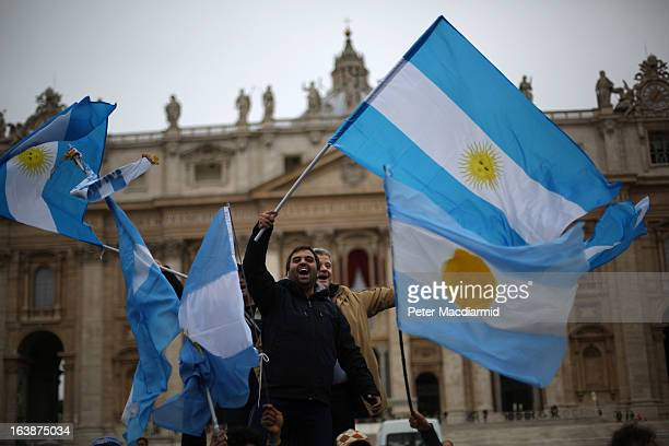 Men wave the flag of Argentina in St Peter's Square after Pope Francis gave his first Angelus blessing on March 17 2013 in Vatican City Vatican The...