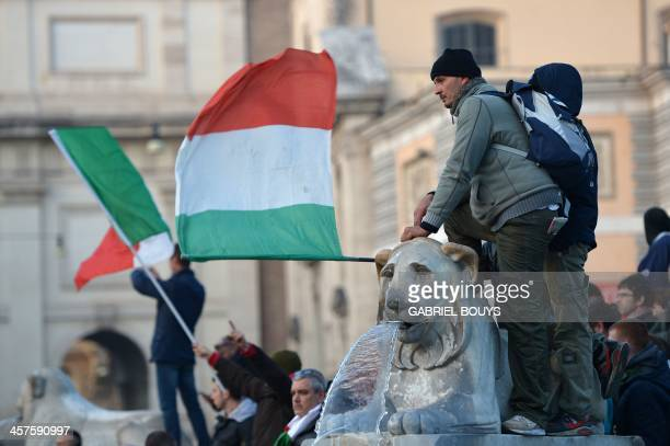 Men wave the Italian national flag during a demonstration of the Forconi against austerity policies and the Italian government on December 18, 2013...