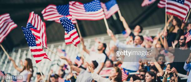 men waving usa flags - american stock pictures, royalty-free photos & images