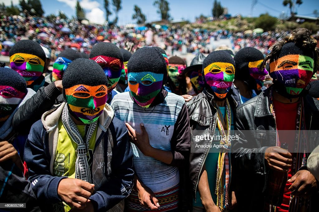 Men, wear colorful mask pose during Takanakuy celebrations in the region of Chumbivilcas, Cuzco in the Andes of southern Peru on December 25, 2014. The Takanakuy is a traditional celebration held every December 25. The celebration can last many days. The word 'Takanakuy' means 'to strike with the fist' and fighters are heating with dances and songs called Wayliyas. Men and women who have had problems with other people during the year are fixing their conflicts at the end of the year with one or several fights. Usually, conflicts are raised by issues related to land or harvesting, stealing animals or insulting the name of the father. Some collisions are caused by love or friendship issues.