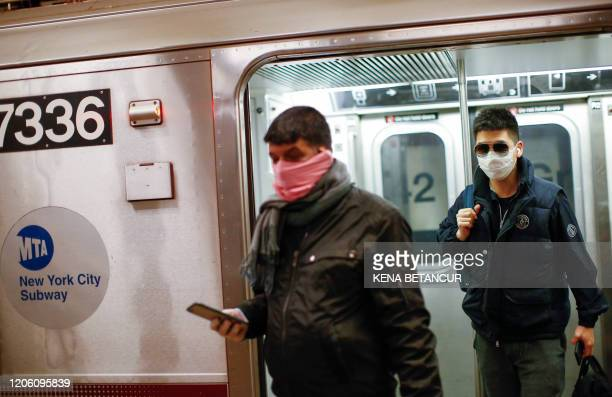 Men wear face mask as they ride on the subway on March 8 2020 in New York City The governor of New York on March 7 2020 announced a state of...
