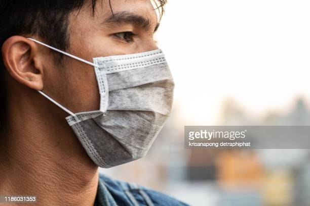 men wear masks to prevent pollution,pollution concept,pollution,pollution concept,pollution,anti pollution mask,globe.toxic fumes - thailand stock pictures, royalty-free photos & images