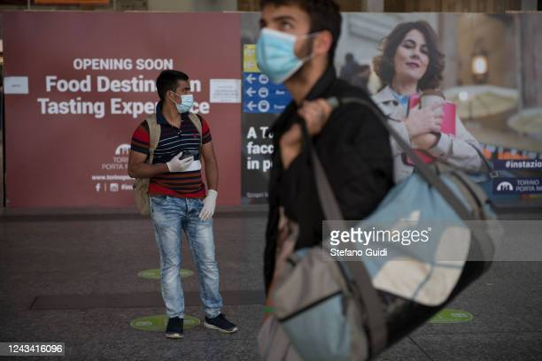 Men wear protective masks wait for the train respecting social distance at the Porta Nuova railway station on June 03 2020 in Turin Italy Today 3...