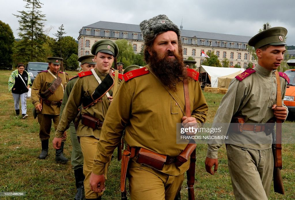 Men wear Russian uniforms as they take part in a historic