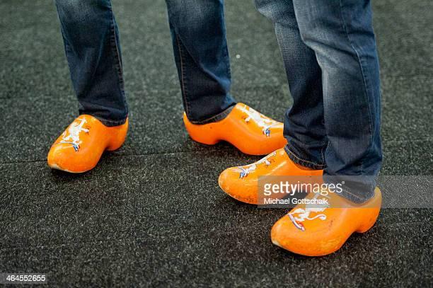 Men wear wooden shoes on Gruene Woche fair on January 17 2014 in Berlin Germany