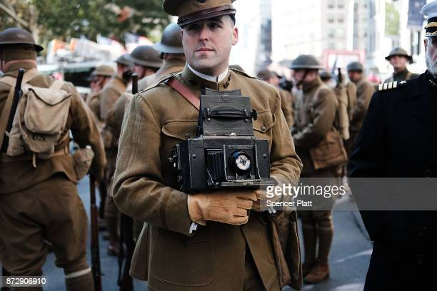 Men wear World War I replica uniforms as they wait to march in the Veterans Day Parade on November 11 2017 in New York City The largest Veterans Day...