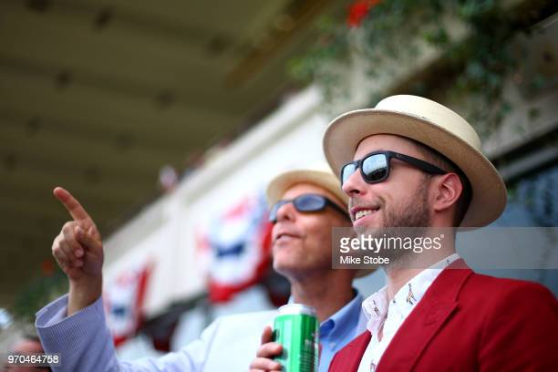 Men wearing a decorative hats look on prior to the 150th running of the Belmont Stakes at Belmont Park on June 9 2018 in Elmont New York
