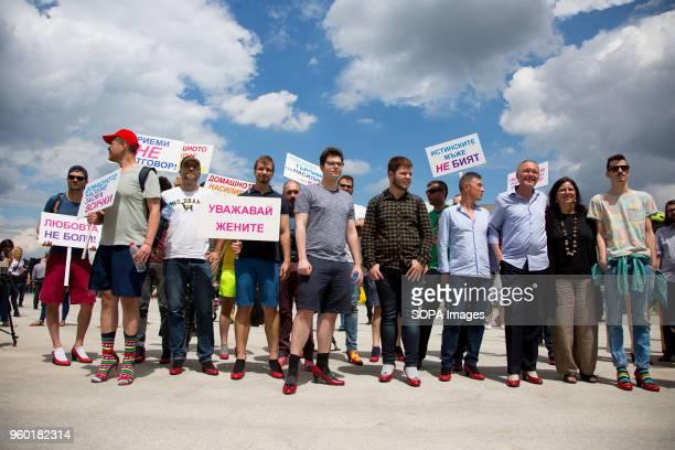 Men wearing highheeled shoes gathered in order to show solidarity with women and the struggles they face during the 'Walk a Mile in Her Shoes'...
