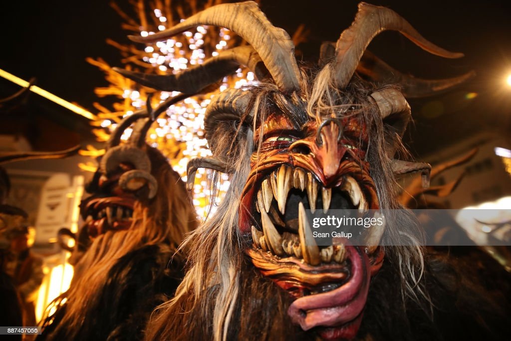 Men wearing horned, wooden masks and dressed as the Krampus creature prepare to participate in the annual Krampus parade on Saint Nicholas Day on December 6, 2017 in Sankt Johann im Pongau, Austria. Several hundred Krampus creatures from the region took part in this year's Sankt Johann parade. Krampus traditionally accompanies Saint Nicholas and angels in a house to house procession to reward children who have been good and warn those who have not, though in recent decades Krampus parades have become an intrinsic part of local folklore and take place throughout the end of November and into the first half of December in the alpine regions of Germany, Austria and Italy. Krampus usually wears large cowbells on his back that he rings by shaking his hips to ward off the evil spirits of winter. He also carries a switch made of branches or animal hair that he uses to whip bystanders.