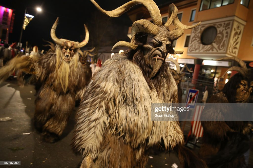 Men wearing horned, wooden masks and dressed as the Krampus creature participate in the annual Krampus parade on Saint Nicholas Day on December 6, 2017 in Sankt Johann im Pongau, Austria. Several hundred Krampus creatures from the region took part in this year's Sankt Johann parade. Krampus traditionally accompanies Saint Nicholas and angels in a house to house procession to reward children who have been good and warn those who have not, though in recent decades Krampus parades have become an intrinsic part of local folklore and take place throughout the end of November and into the first half of December in the alpine regions of Germany, Austria and Italy. Krampus usually wears large cowbells on his back that he rings by shaking his hips to ward off the evil spirits of winter. He also carries a switch made of branches or animal hair that he uses to whip bystanders.