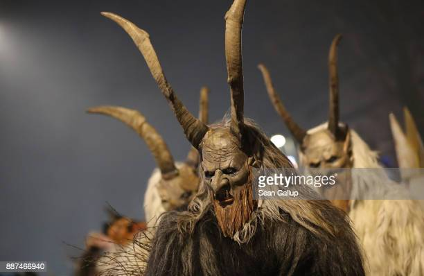 Men wearing horned wooden masks and dressed as the Krampus creature participate in the annual Krampus parade on Saint Nicholas Day on December 6 2017...