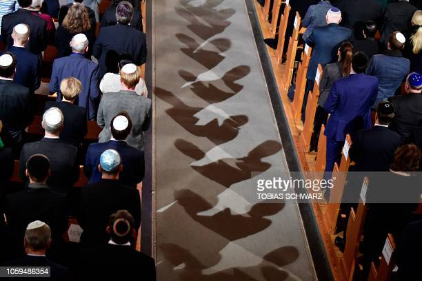 Men wearing Jewish kippa skullcaps attend a ceremony at the Synagogue Rykestrasse in Berlin on November 9 2018 to commemorate the 80th anniversary of...