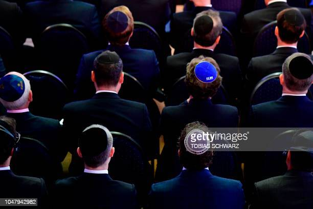 Men wearing jewish kippa skullcaps attend an ordination ceremony at the Bet Zion synagogue in Berlin on October 8 2018