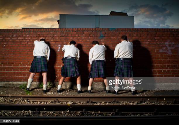 men wearing kilts - kilt stock photos and pictures