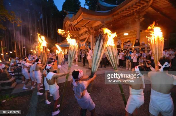 Men wearing loinclothes hold flaming torches during the Hayama Fire Festival on August 15 2018 in Tomioka Fukushima Japan The 'Obon' or 'Bon' a...