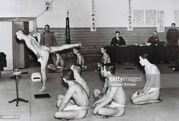 Men wearing loincloths attend health check of the military conscription at Higashinari ward hall on April 1 1940 in Osaka Japan