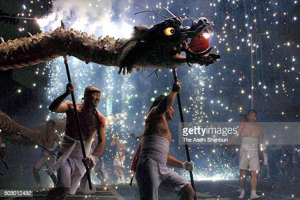 Men wearing loincloths perform dragon dance during the Ryujin Fire Festival at Gero Hot Spring area on August 1 2006 in Gero Gifu Japan