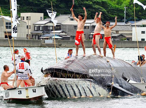 Men wearing loincloths reproduce an ancient whaling during the Kayoi Whale Festival on July 19 2015 in Nagato Yamaguchi Japan