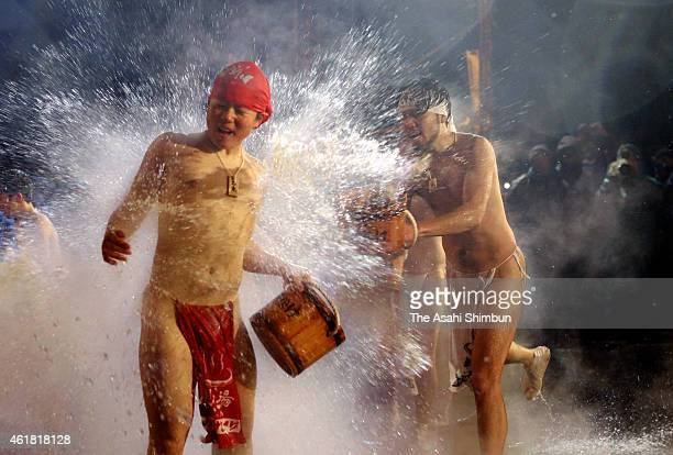 Men wearing only loincloths splash hot water each other at minus 3 degrees Celsius during the Yukake Festival at Kawarayu Hot Spring district on...