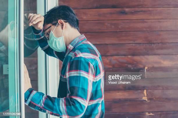 men wearing protective mask to protect against covid-19 worried about unemployment. - fusione del nocciolo di un reattore nucleare foto e immagini stock