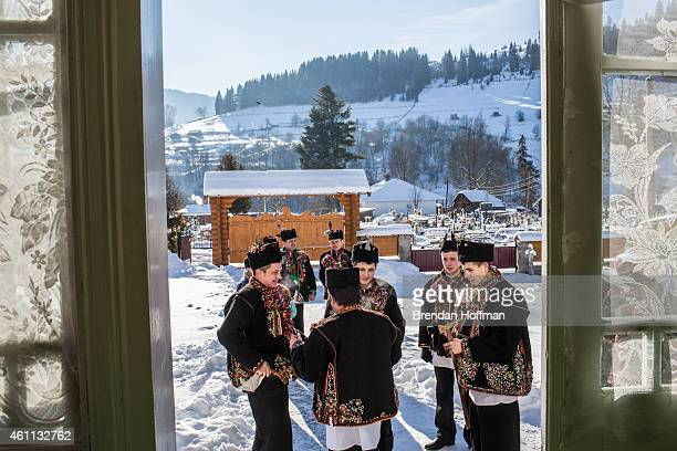 Men wearing traditional Hutsul clothing gather at Holy Trinity Church to celebrate the Orthodox Christmas on January 7 2015 in Iltsi Ukraine The men...