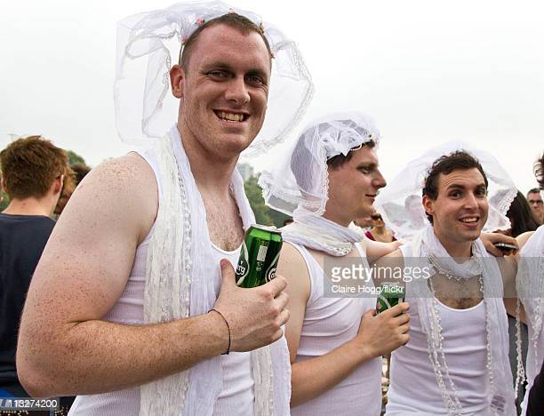 Men wearing wedding dresses watch the Royal Wedding parade during the Royal Wedding of Prince William to Catherine Middleton, on April 29, 2011 in...