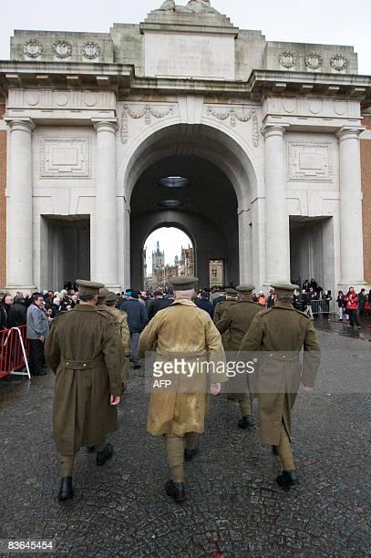 Men wearing World War I uniforms parade near the Menin Gate during ceremonies commemorating the end of World War I in Ypres Belgium on November 11...