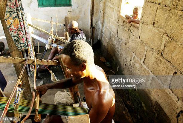 A men weave Kente cloth in eastern Ghana May 13 2004 Ghana is the most tourist friendly country in Anglophone West Africa boasting warm and friendly...