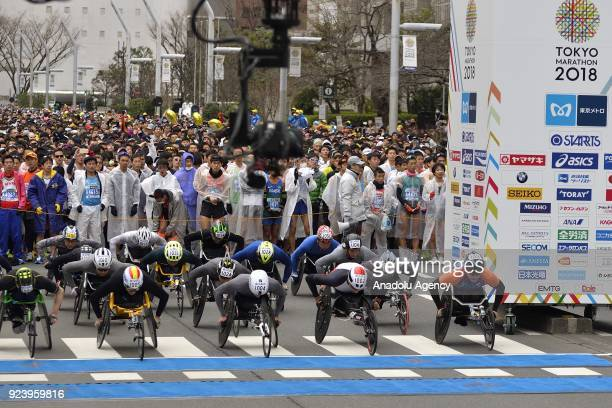 Men wheelchairracers leave the starting line of the12th Tokyo Marathon in front of the Tokyo Metropolitan Government in Tokyo Japan on February 25...